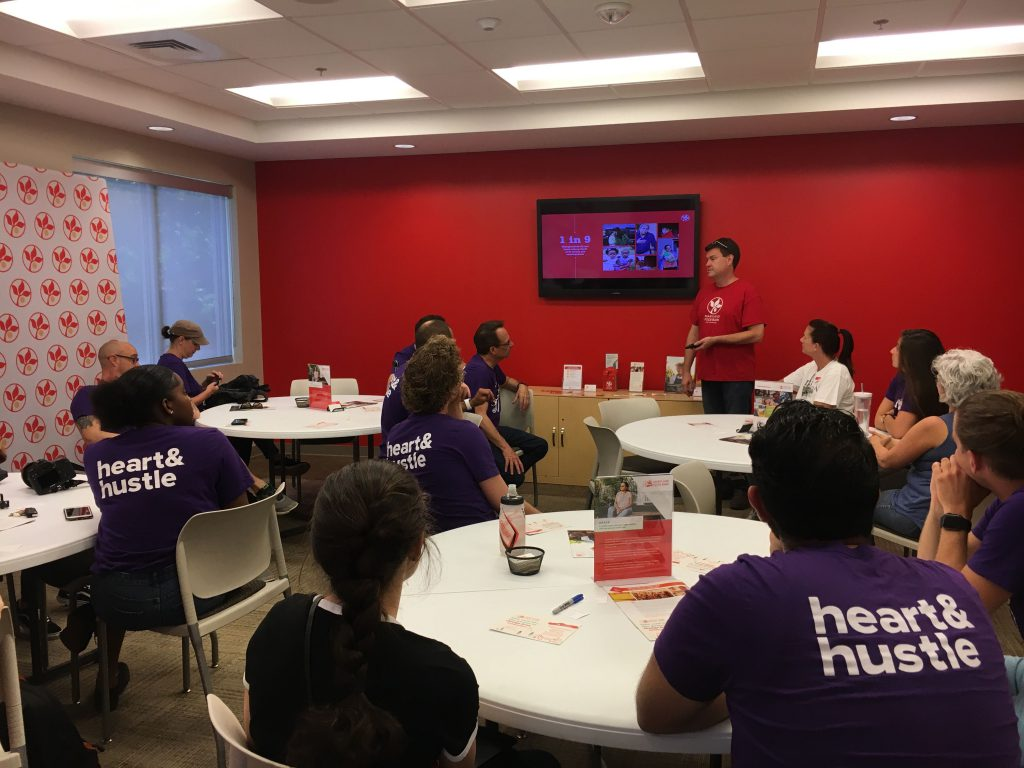 idfive team members listen to Maryland Food Bank representative