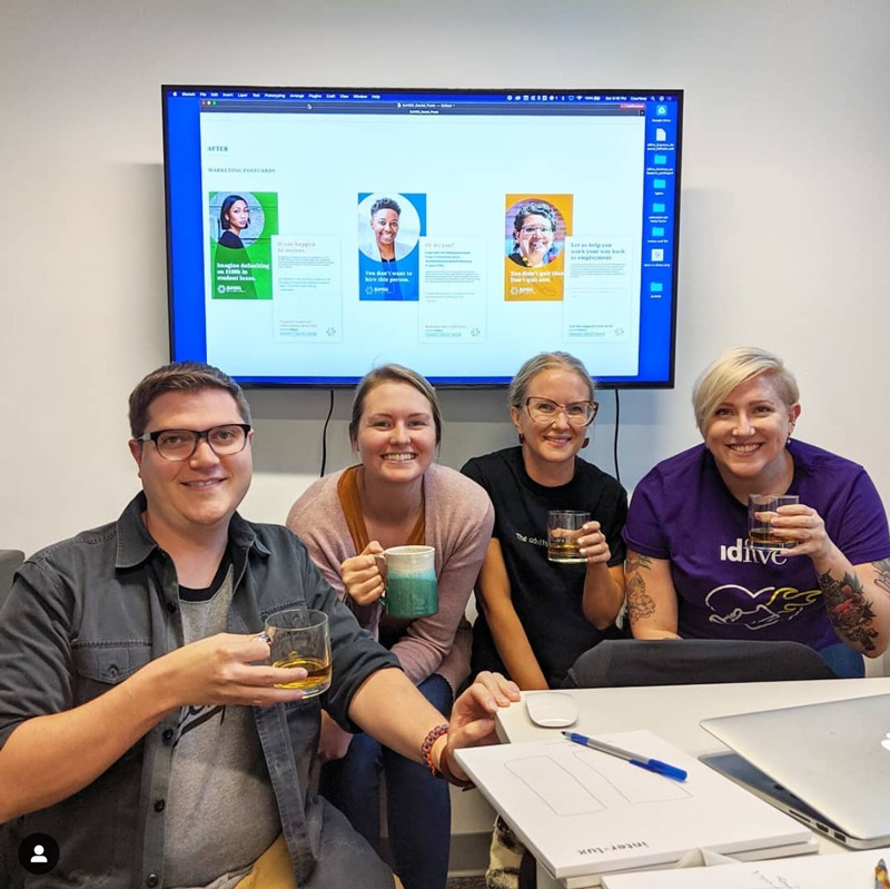 four marketers having a drink to celebrate their work