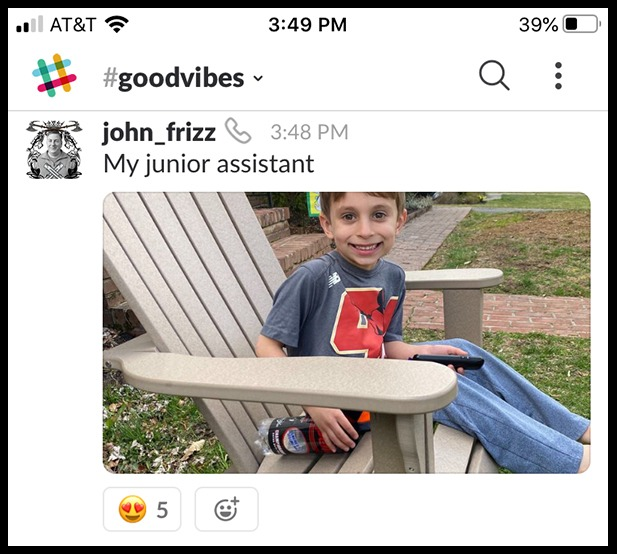 Photo of a kid sitting outside in a slack conversation
