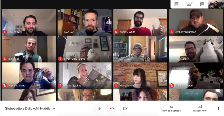 Google meeting with Fivers holding various objects from the scavenger hunt